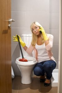 plunger-woman-toilet-phone