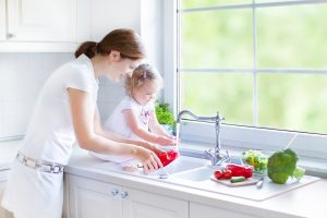 mother-daughter-vegetables-kitchen-sink